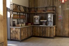 Nandos restaurant by B3 Designers, Nice millwork, reclaimed wood and blackened metal