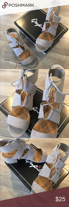 Brand new Qupid trendy sandals Color: taupe suede. Perfect spring sandals! Adorable lace up detail, perfect low heel. Never worn, brand new with box. Size 8 1/2. Qupid Shoes Sandals