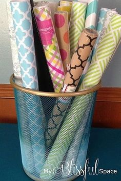Reuse a wastebasket to corral your wrapping paper. (Dec 2014)