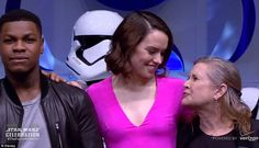 The vet meets the new faces: Fisher smiled as she posed with John Boyega and Daisy Ridley...