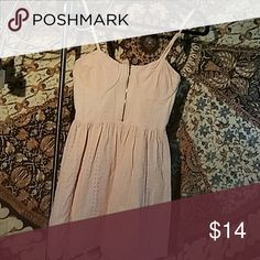 Forever 21 sz. M Pale pink eyelet summer dress This cute little number is pale pink, 100% cotton, and would be perfect for your next picnic. It features adjustable straps, a zipper down the middle of the chest for decor, as well as down the side for a more fitted look; also, elastic in the back, and an underwire for support. The top layer of fabric is an eyelet pattern, with a slip-style lining sewn in. Lightweight, breathable, and chic, you'll feel adorable in this simple, yet elegant day…