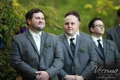 Groomsmen with peacock boutonnieres and sleek gray suits #peacock #graysuits #whatgroomsmenwear  @Vecoma at the Yellow River