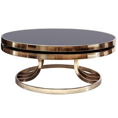 Italian Brass and Glass Swivel Coffee Table | From a unique collection of antique and modern coffee and cocktail tables at http://www.1stdibs.com/furniture/tables/coffee-tables-cocktail-tables/