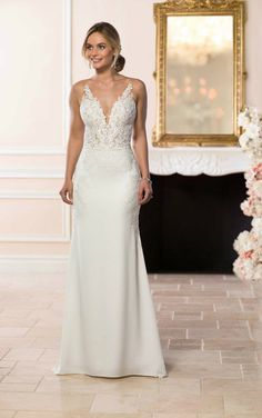 875df51900f Modern meets sexy in this sleek silhouette by wedding dress designer Stella  York. Matte lace and silky crepe create a sheath silhouette with plunging  ...