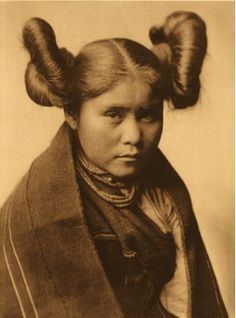 Hair style tells the marital status (American Indian)    With the two side buns = I'm still a single lady!    Chaiwa-Tewa, 1922: Photo by Edward S. Curtis