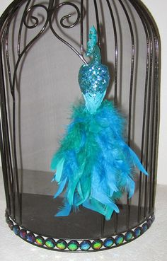 Hey, I found this really awesome Etsy listing at http://www.etsy.com/listing/168460755/teal-glittered-peacock-ornamentchristmas