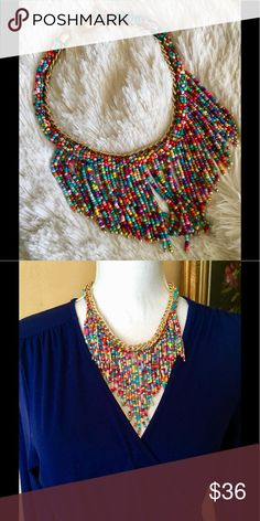 "Tribal Beaded Gold Chain Fringe Statement Necklace Very similar to the African Maasai traditional fringe collar. Set in a gold chain, which measures approximately 18"" with a 3"" extender. Fringe is 4"" at the longest part in the center. Would go with a variety of outfits due to the different colors! NRC Jewelry Necklaces"