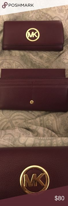 Wallet Micheal kors walked only used for a week . Plum color just beautiful Michael Kors Accessories