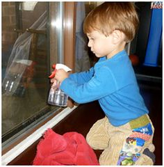 50 Montessori Activities for 2 Year Olds - cleaning help with a small water spray bottle and towel