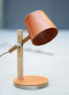 Materials: Oak, Birch, Leather Year: Spring 2012  Leather is a lamp series where I have explored the leather material. I wanted to combine the nostalgic and beautiful feeling that leather represents with a newer and more contemperary look. The...