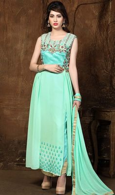 Be the picture of ethereal perfection in this turquoise color embroidered georgette pant style suit. The wonderful lace and resham work across dress is awe-inspiring.  #sleevelessdresses #indiansalwarsuit #longgeorgettedress