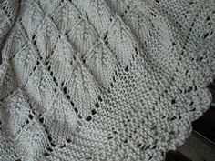 The Cherry Leaf Shawl features a pretty leaf pattern and surrounded by a reversible edging that is knitted on so there is no sewing.