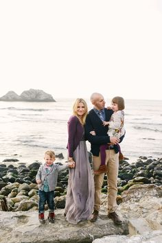 Please love the little boy's bow-tie and cardigan.  Dressy casual... the perfect mix for family pictures. Mom's long, flowy dress and Dad's tie.  This couldn't be more perfect.