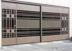the panel designs on the ends are pretty good looking. Steel Gate Design, Front Gate Design, Main Gate Design, Door Gate Design, House Front Design, Metal Gates, Wrought Iron Gates, Contemporary Garage Doors, Grill Gate