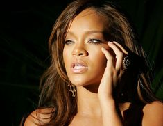 View Rihanna information, find all Rihanna lyrics.    Robyn Rihanna Fenty (born February 20, 1988), known by her stage name, Rihanna, is a Bajan singer. Her song Umbrella was one of the highest-selling songs of 2007 and her 3rd album Good Girl Gone Bad was critically acclaimed, helping propel her to superstar status. She has attained twelve Billboard Hot 100 number ones thus far and is the second Bajan artist to win a Grammy Award. She is also a cultural ambassador for Barbados.