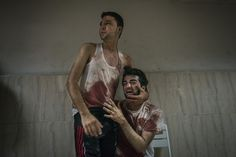 2015, General News, 3rd prize stories, Sergey Ponomarev GAZA CONFLICT 23 July 2014 Two brothers from the El Agha family grieve their father who was killed after shelling in Khan Yunis. After weeks of rising tensions following the killing of three Israeli teenagers and the apparent revenge killing of a Palestinian teenager, Israel began a major offensive against Hamas in Gaza on 8 July.