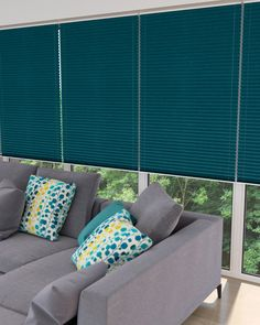 Add a block of colour into your living room with our pleated blinds. #pleatedblinds #home #interiordesign #tealblinds Please visit us at www.barnesblinds.co.uk
