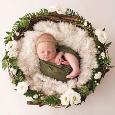 Adorable Baby Photography in basket with flowers and garland