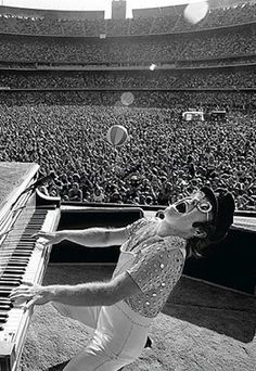 Elton John on stage at Dodger Stadium, 1975. Photo by Terry O'Neill.
