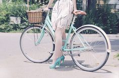 Own an old fashioned pastel coloured bike