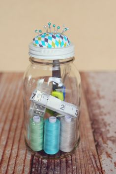 We thought this would be a fun gift to give to your Mom or friends that are mothers! A basic sewing kit in a mason jar. Super simple. Super cute. Super handy. Here's what we put in ours: scissors seam ripper measuring tape box of safety pins chapstick wintergreen Altoids pins To make the pin …
