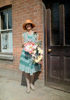 England in 1928 - A young girl sells artificial flowers for charity on Alexandra Day, in Kent. The first Alexandra Rose Day was held in 1912; it commemorated the arrival in Britain of Princess Alexandra of Schleswig-Holstein-Sonderburg-Glücksburg, from Denmark, in 1862.