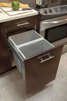 End kitchen floor clutter: put waste baskets out of sight and undercover with this waste center cabinet.  Slide-out unit makes neatness easy.
