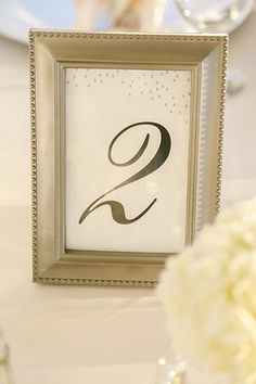 A simple gold frame elevates your table number cards from plain white to classic elegance.