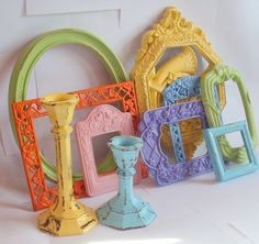 Colorful frames! love this idea for a baby's room, get old, beat-up vintage frames and paint them in coordinating colors. Would be a neat way to have lots of family photos in there, or even scraps of fabric to brighten the room.