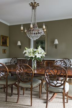 Sconces And Chairs Flank A Short Sideboardone Large Chandelier Simple Dining Room Area Rug Inspiration Design