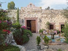 A restored ancient stone wall presides over the lush terrace garden at a picturesque residence not far from San Miguel de Allende, Mexico. Spanish Style Homes, Spanish Revival, Spanish House, Spanish Colonial, Architectural Digest, Spanish Garden, Spanish Architecture, Hacienda Style, Hacienda Decor