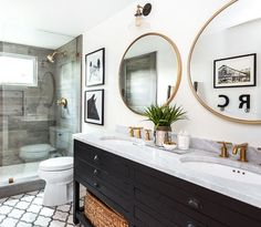 A large framed mirror is impressive and elegant. There are an endless number of ways to design a bathroom, from creating a layout to choosing colors and fixtures. When it comes to decor, mirrors are a necessity in the bathroom — but that doesn't mean they have to be basic or lack style.