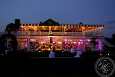This summer wedding at Trump National Golf Club in Bedminster, New Jersey featured bold fuchsia lighting to add color to the ballroom.  #uplighting #weddinglighting #modernwedding #luxurywedding #njwedding