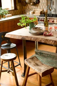 rustic wood table, iron legs, wood stools, really sweet