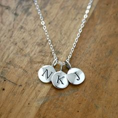 Here's your everyday necklace! Sterling silver charms are on a sterling silver chain. Wear the initial(s) of the people you love most. Simple and light enough to wear everyday.