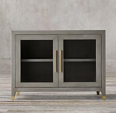 RH's Graydon Shagreen Glass Double-Door Sideboard:Our collection is inspired by the sumptuous refinement of 1930s Paris. Understated forms are clad in rich shagreen-embossed leather, an exacting reproduction of the texture and pattern of natural stingray hide. Tapering feet capped in metal add a refined finishing touch.SHOP THE ENTIRE COLLECTION ▸