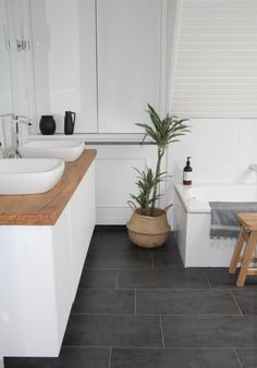 I like this colour scheme. Charcoal textured tiles, white walls. Also like the ideas of 2 Bassin, plenty of storage and don't mind wooden top