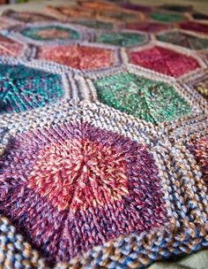 Berocco Komb Hexagon Knit Afghan. Might try for something smaller, like a cool purse or something.