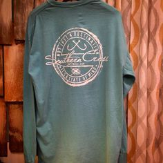 """We have 2 XL's left in this gorgeous teal long sleeved """"fishin'"""" shirt!!! From Southern Cross!! #unisextee #southerncrossapparel #weship #comfortcolors #shoplocal #supportsmallbusiness #shopstandrews #shopthecrystalpistol #deepsouthroots by shopthecrystalpistol"""