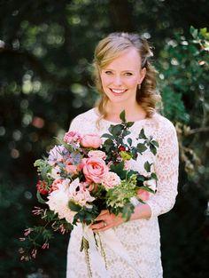 Lush bridal bouquet, Short lace wedding dress by Tibi.  Photo Leo Patrone.