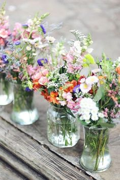 I don't know if we need it to be mason jars, but I like the wild/free feel of the flowers here. #weddingflowers