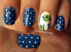 Navy polish with white polka dots and pretty flowers nail art