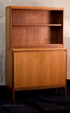 A Gordon Russel designed teak and rosewood cabinet featuring two doors and shelves.  c 1960