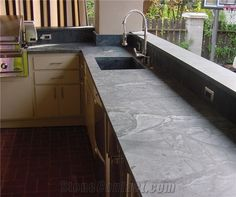 Soapstone Countertops can be a nice finish to your outdoor kitchen. View some of our outdoor kitchens, countertops, soapstone BBQ & Fireplaces. Soapstone Countertops Cost, Outdoor Kitchen Countertops, Kitchen Countertop Materials, Kitchen Counters, Sandstone Countertops, Kitchen Sink, Kitchen Cabinets, Oak Cabinets, Kitchen Backsplash