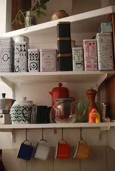 "Sneak Peek: Lydia Nichols and Julia Lines Wilson ""We love tea. All of those tins are full of different tea (mostly black varieties and yerba mate) which we get at Premium Steap, a truly excellent loose tea shop in Center City Philadelphia. Sadly, the kitchen is too small to display our many and varied tea cups, but we do keep out enamel mugs we bought on a trip last summer to Berlin."" #sneakpeek"
