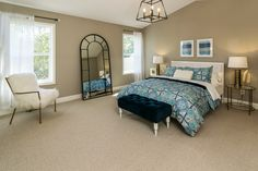 Master Suite with walk-in closet, private bathroom and vaulted ceilings.