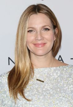 Drew Barrymore's hair is a beautiful blend of shades that make up an overall flattering look.  - GoodHousekeeping.com