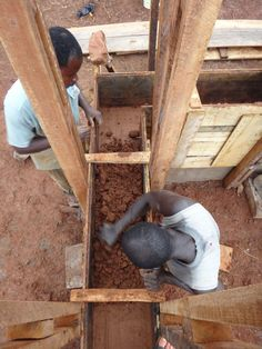 """Karolina and Wayne Switzer, participants of the Nka Foundation's """"10×10 Shelter Challenge"""" design and build a 10 by 10 feet shelter deep in the heart of Ghana."""