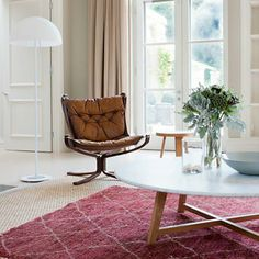 layer a patterned rug on top of a natural toned rug | Roseland Greene