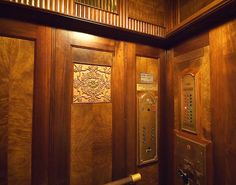 The wood panelled interior of 1930's elevator